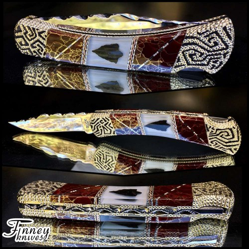 Custom Buck 110 with genuine Native American Arrowheads inlaid with Red Stone Gold Matrix