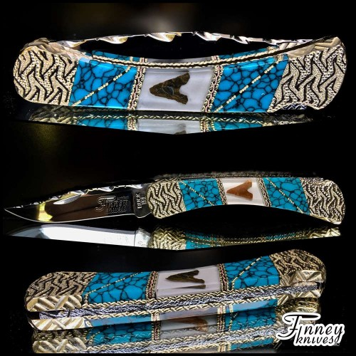 Custom Buck 110 with genuine Neolithic Arrowheads from Africa inlaid with turquoise web