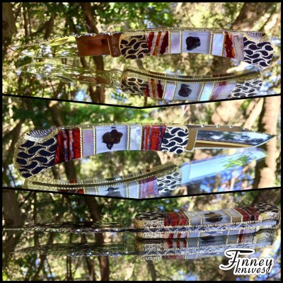 Custom Buck 110 with Genuine Meteorites inlaid with mother of pearl and mammoth tooth