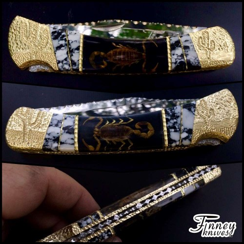 Custom Buck 110 with Real Scorpions inlaid with Dalmatian stone by Garett Finney
