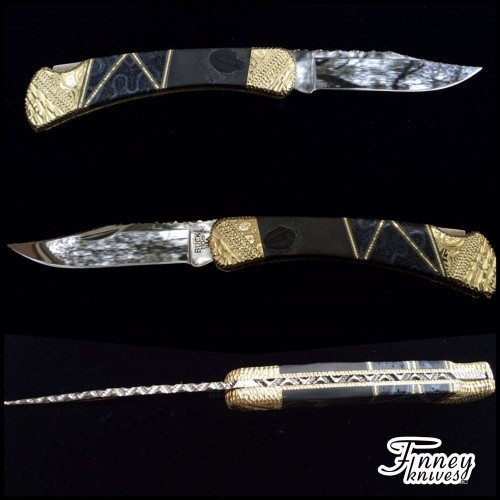 Custom Buck 110 with Genuine Trilobite Fossils from Utah with Black Fossil Coral inlay